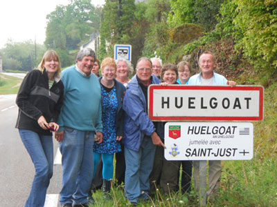 Members of the St Just Twinning Association with the Huelgoat sign
