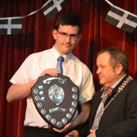 Christopher Morris being presented with his trophy by Town Mayor Brian Clemens