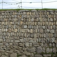 Close up photo of the outside wall of the Plain-an-Gwarry showing the repair works