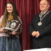 Lily Robinson, winner of Junior Citizen being presented with her award by Mayor Brian Clemens