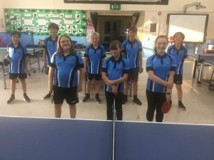 Cape Table Tennis Club team members wearing their new shirts with funds provided by St Just Town Council